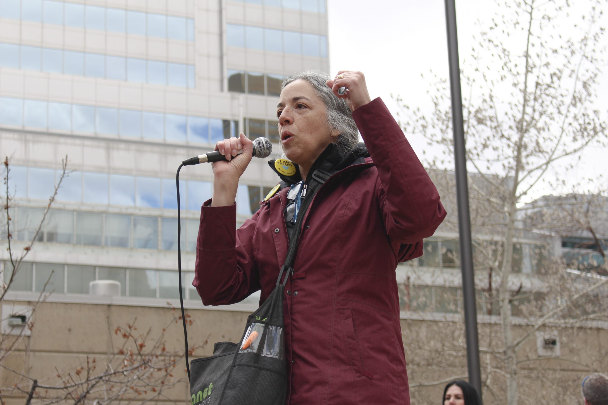 Adele Sanoy speaks briefly about prizes for best costume and dance moves during the march at the ÒSave Small BusinessÓ rally taking place at Courthouse Park in downtown Calgary on April 11, 2021. Sanoy is a volunteer with Freedom4Canada, and she has played a large role in the rallies that have gone on with Calgary Freedom Central. People attended the rally/march as a sign of support for the businesses that are facing hardships as a result of COVID-19 and the provincial lockdown, but also to express disdain for mask usage, vaccines, and compliance with the government and the enforcement of said closures. (Photo by Alejandro Melgar/SAIT)