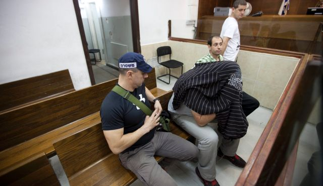 A suspect in the Barnoar gay youth center shooting at court - June 6 2013. Photo by Moti Milrod