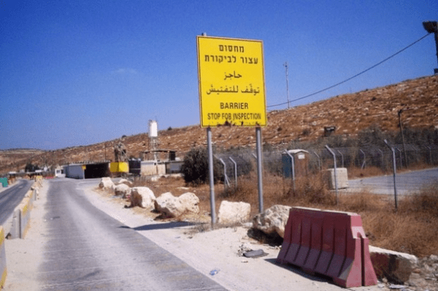 File photo shows an Israeli checkpoint on a road in Ramallah (Mel Frykberg)