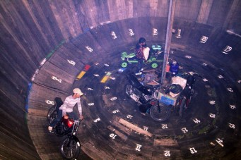 motorbike stunt, riding in a closed barrel wall