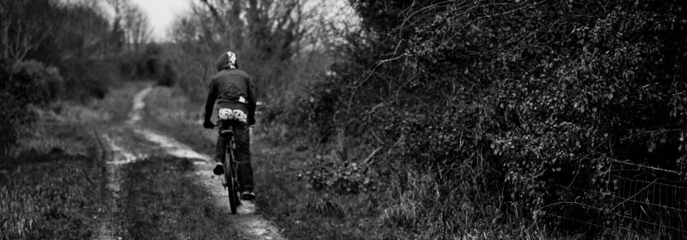 Cyclist on the trail - Ballycastle - A photo by Alex Leonard