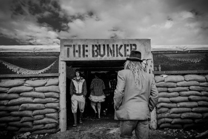 Festival attendees coming and going from the bunker.