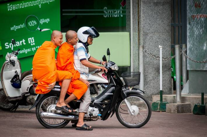 Monks on a moped - A photo by Alex Leonard