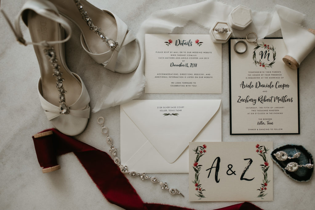 Ariele and Zach's Texas winter wedding with deep reds and luscious wedding floral designs featured on Alexa Kay Events. See more winter wedding ideas at alexakayevents.com!