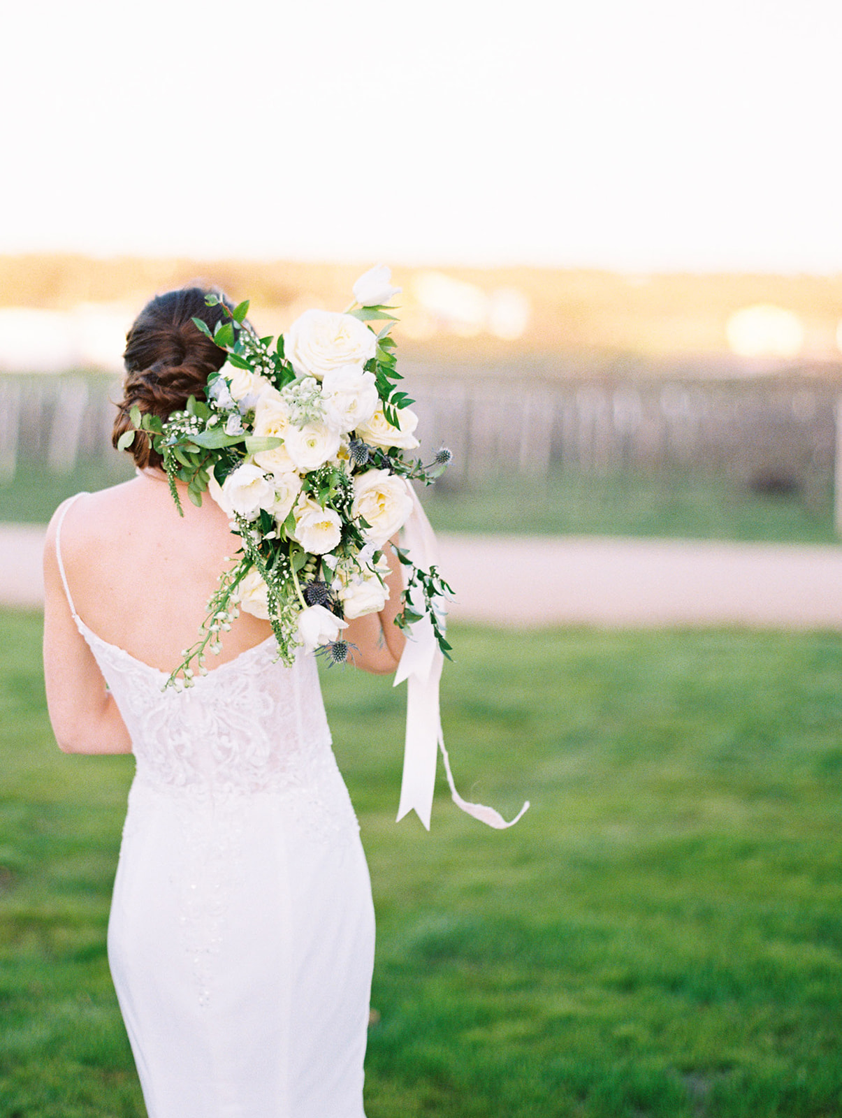 White wedding bouquet: Elopement vineyard wedding at Umbra Winery by Alexa Kay Events. See more wedding ideas at alexakayevents.com!