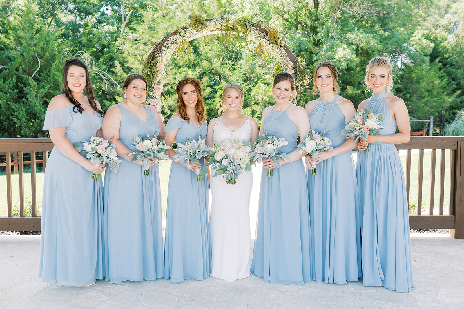 Light blue bridesmaids dresses: | Romantic blue Texas wedding at Spring Venue by Alexa Kay Events