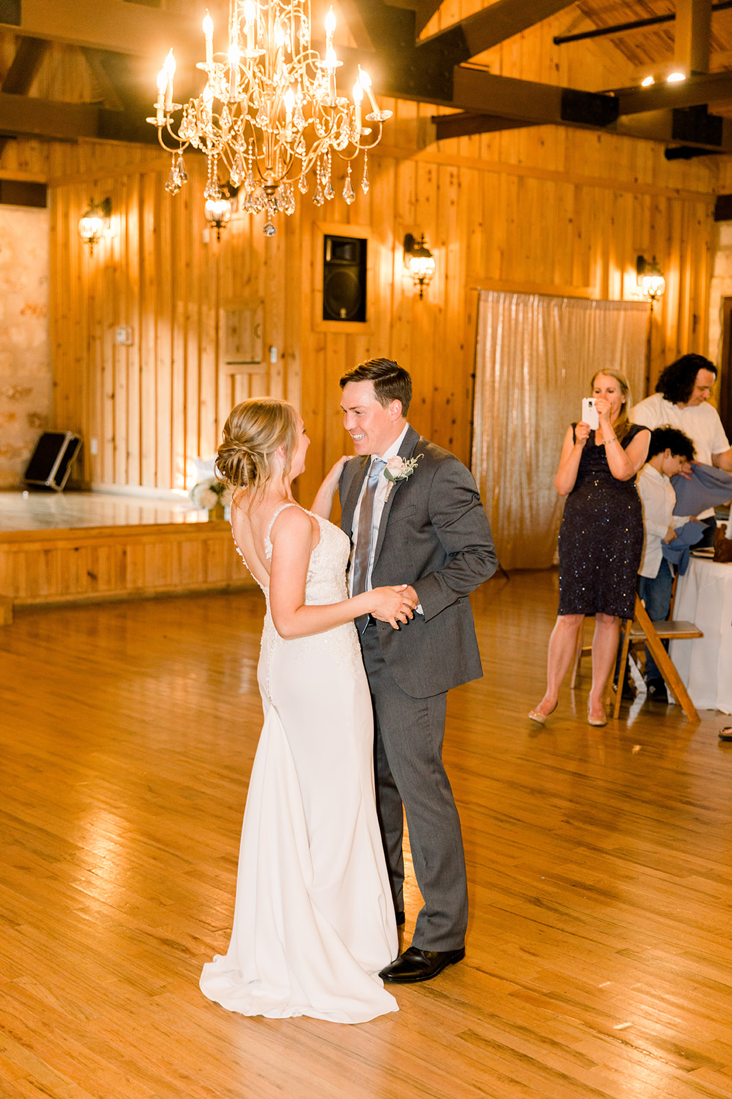 Bride and groom first dance: | Romantic blue Texas wedding at Spring Venue by Alexa Kay Events
