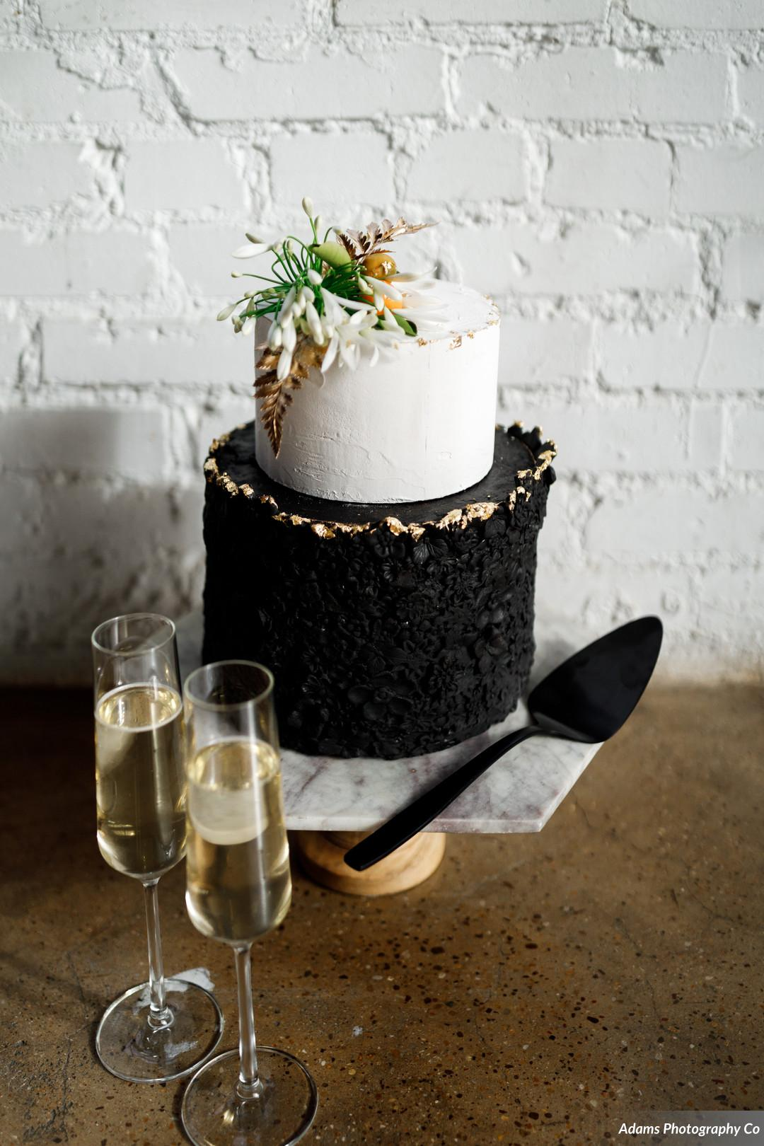 Modern black and white wedding cake: Black, White, and Gold Modern Wedding Inspiration featured on Alexa Kay Events