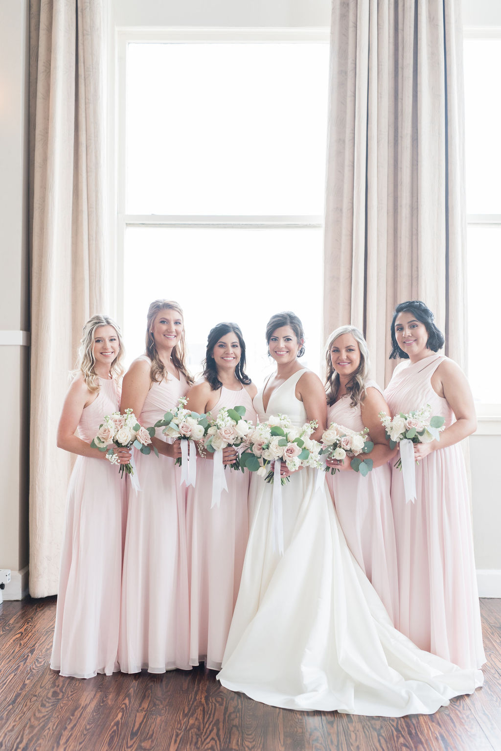 Mismatched blush bridesmaid dresses: Dusty Blue and Blush Wedding at The Room on Main featured on Alexa Kay Events!