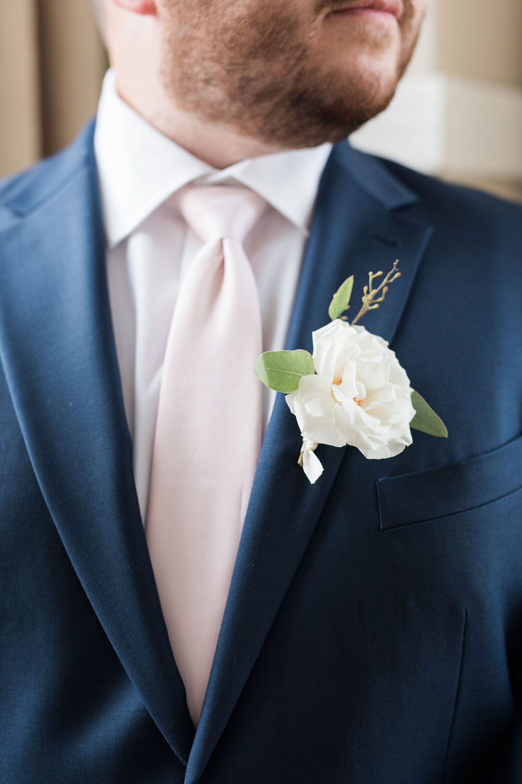 Ivory wedding boutonniere: Dusty Blue and Blush Wedding at The Room on Main featured on Alexa Kay Events!