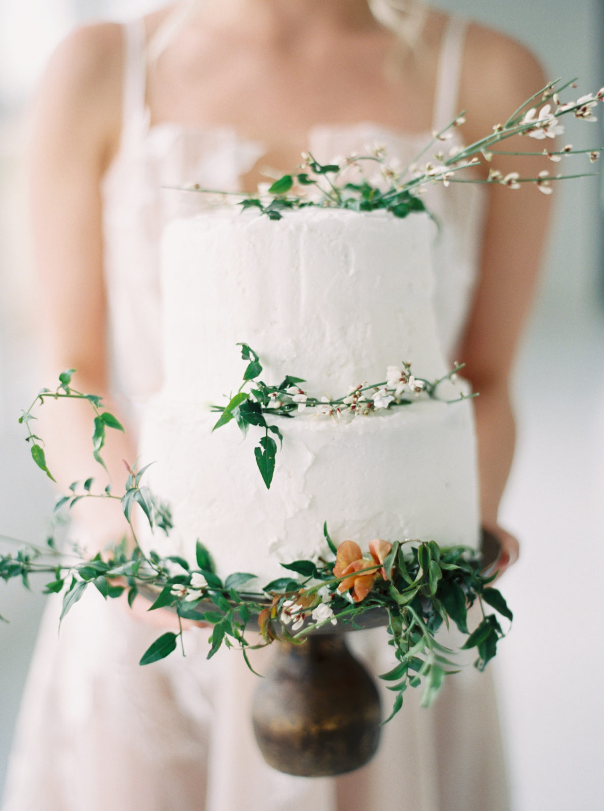 White wedding cake with greenery featured on Alexa Kay Events blog!