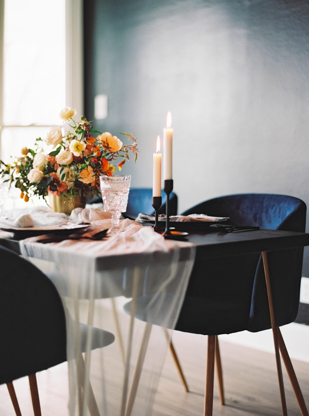 Wedding table decor inspiration with navy blue chair featured on Alexa Kay Events