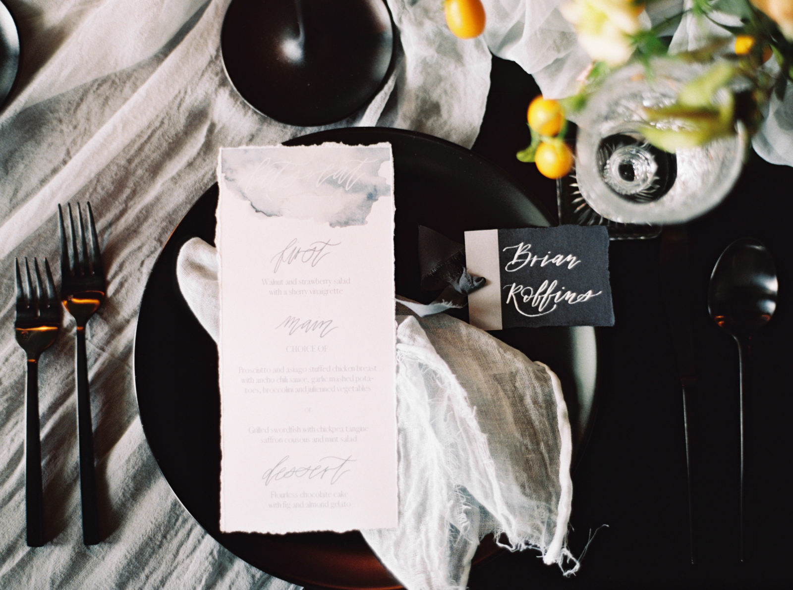 Black and white wedding place setting for wedding editorial on Alexa Kay Events.