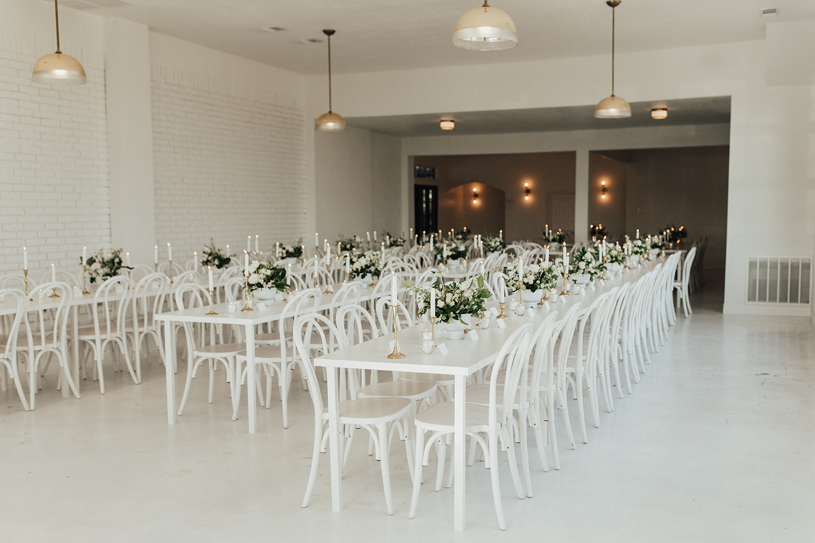 All White Wedding Decor with Greenery at The Emerson