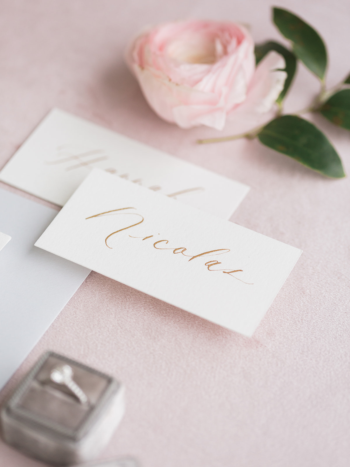 White and gold calligraphy wedding escort cards: Pink Floral Wedding Inspiration at The Lumen Room featured on Alexa Kay Events