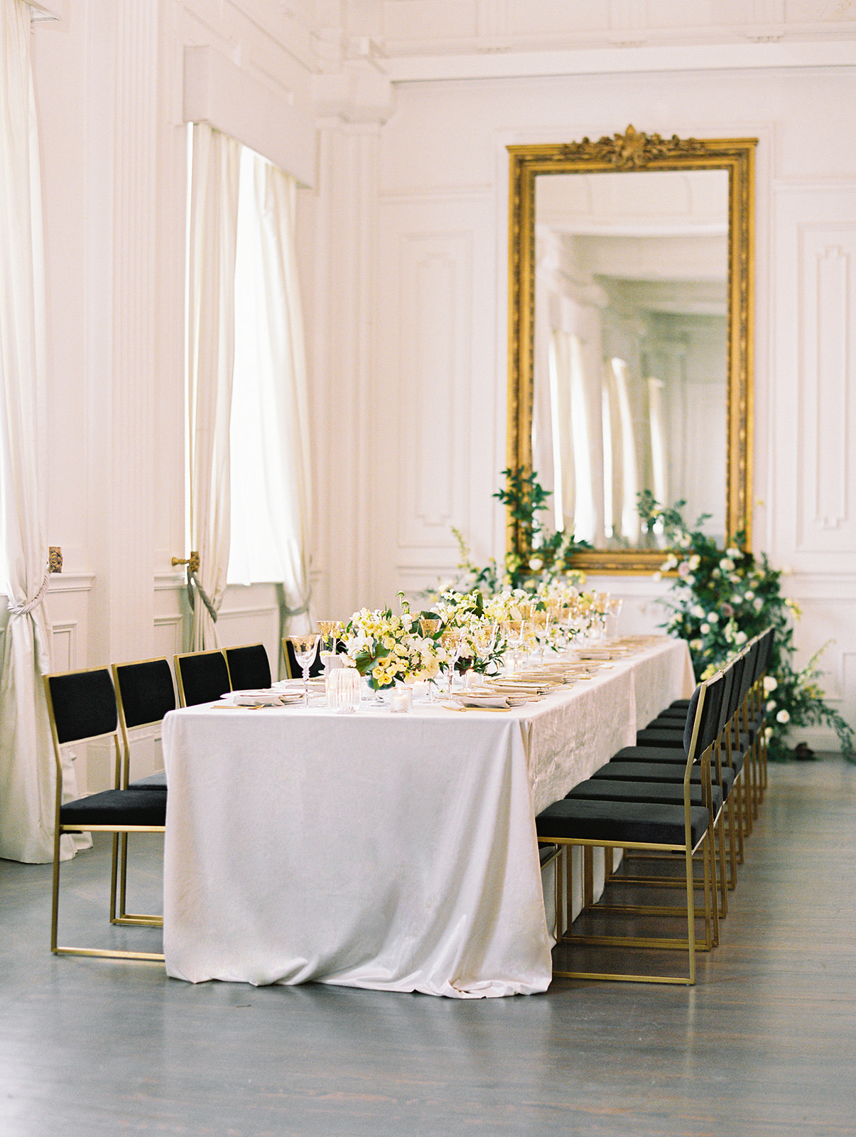 Modern black and gold wedding table chairs from Posh Couture Rentals