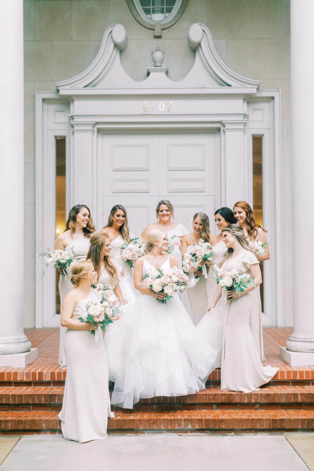 Neutral bridesmaid dresses and wedding bouquets