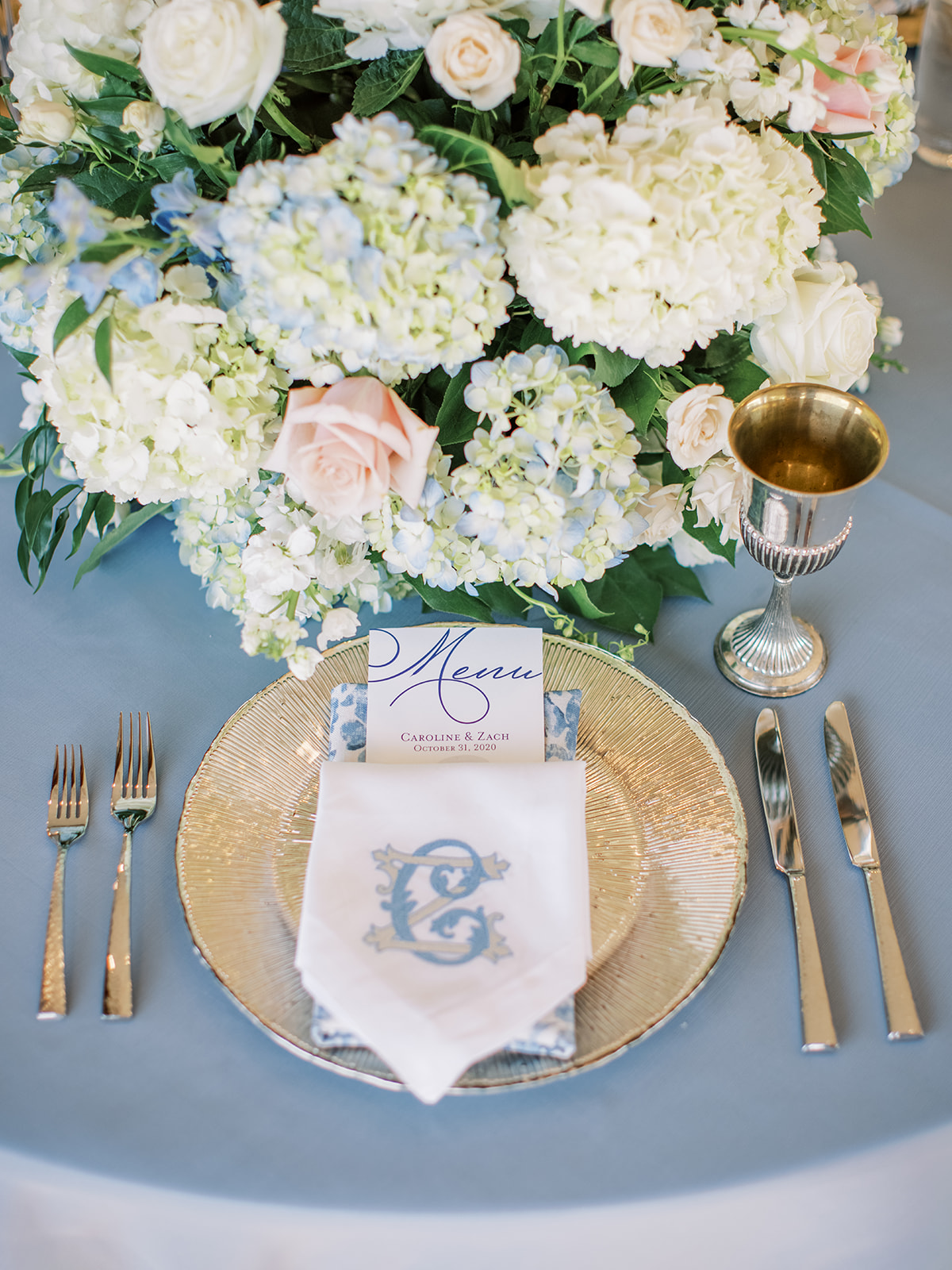 Gold wedding plate chargers and white hydrangea centerpieces