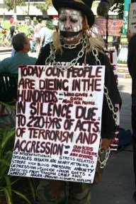 An aboriginal woman protests the plight of her people on Human Rights Day in Melbourne, Australia.