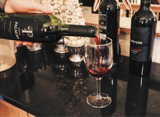 alex pouring wine