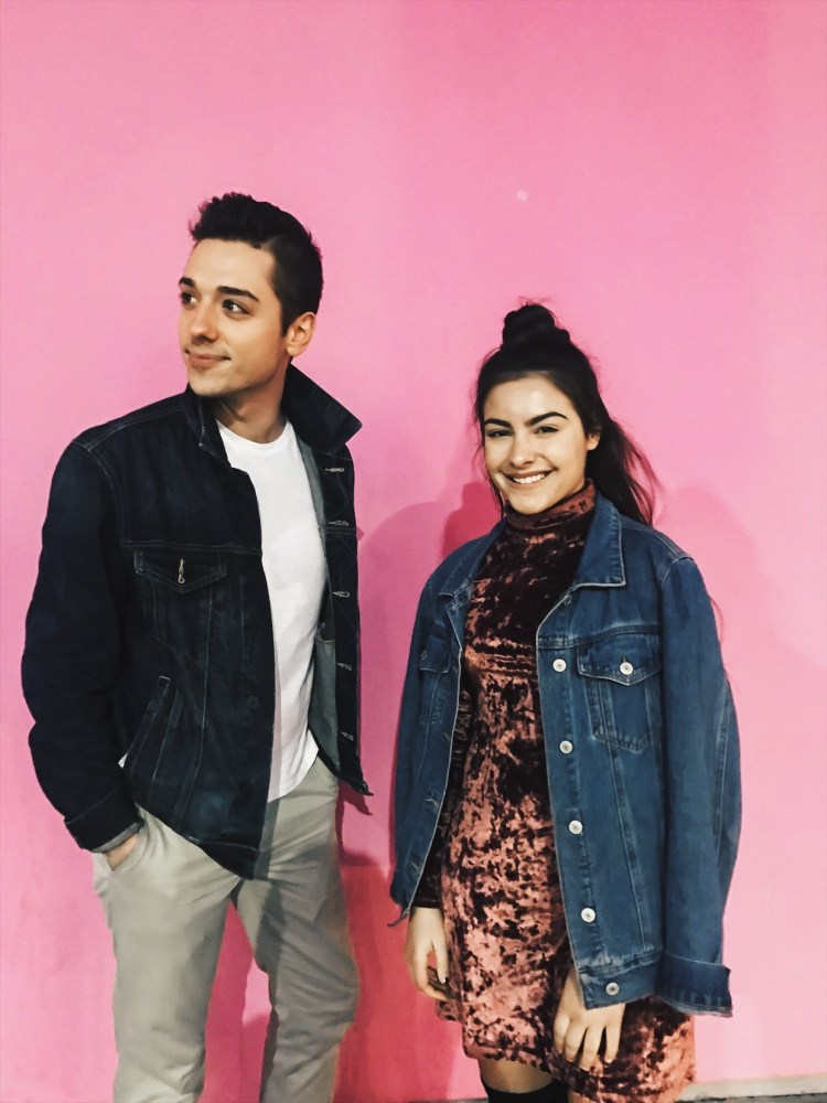 mike and chloe on pink wall