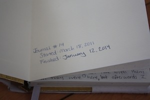 photo showing the start and finish dates in the front of a journal