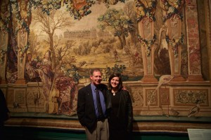 Bruce Dean and Alexandra Hinrichs in front of The Chateau of Monceau/Month of December tapestry (photo courtesy of Bruce R. Dean)