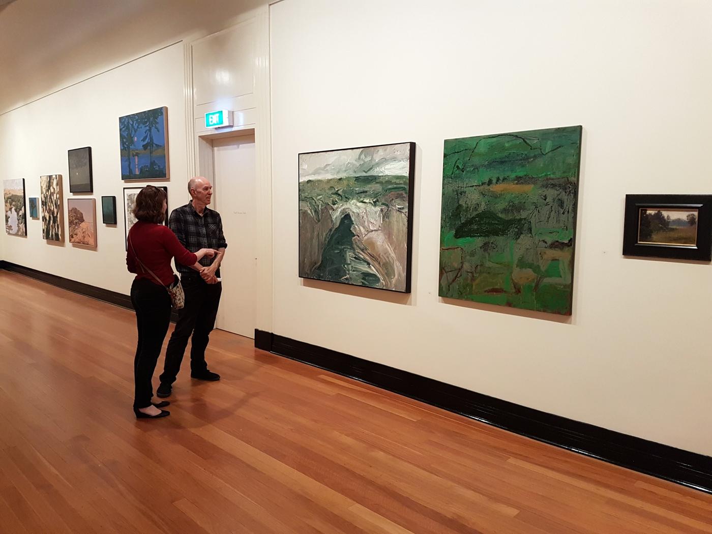 Photo of visitors looking at paintings at the Len Fox Painting Award