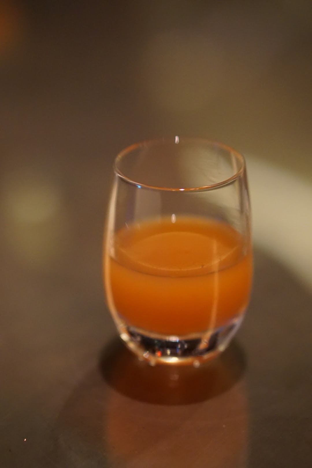 A bright tangerine palette cleanser