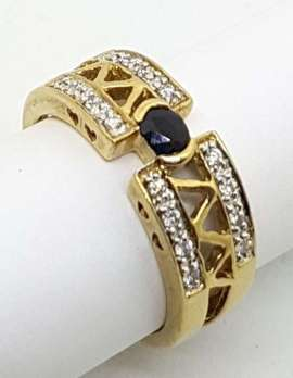 single black sapphire and diamonds on 9carat gold ring