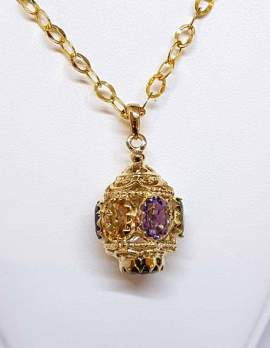ornate gold spherical drop pendant with 3 gems