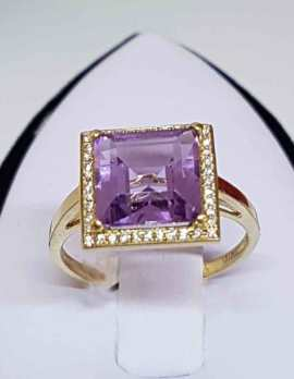 9ct Gold Square Ring Large Square cut Amethyst surrounded by small diamonds