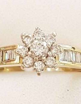 18ct Gold Diamond Daisy with Baguette Shoulders Engagement Ring