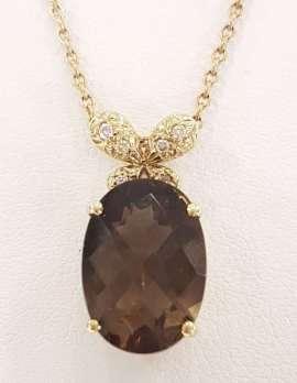9ct Gold Oval Smokey Quartz and Diamond Pendant on 9ct Chain
