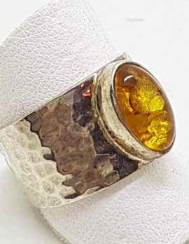 Sterling Silver Oval Natural Amber Ring - in Wide Beaten Design Ring