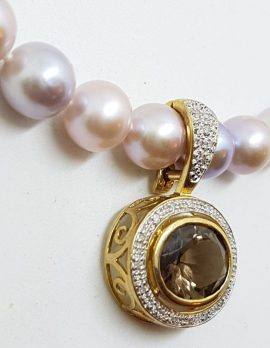 9ct Gold Oval Smokey Quartz surrounded by Diamonds Enhancer Pendant on Pearl Necklace