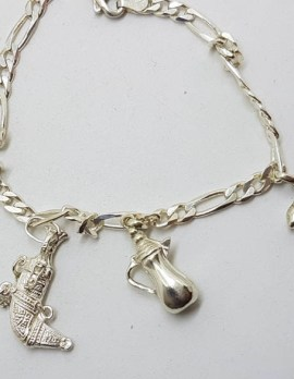 Sterling Silver Vintage Charm Bracelet with 4 Assorted Charms