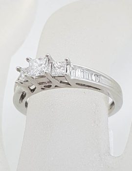 18ct White Gold Claw Set and Channel Set Three Princess Cut with Baguette Diamond Ring - Engagement Ring