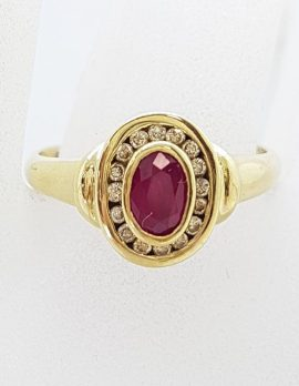 9ct Yellow Gold Oval Bezel Set Natural Ruby with Channel Set Diamond Cluster Ring