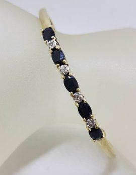 9ct Yellow Gold 5 Oval Natural Sapphire and 4 Diamond Cuff Bangle - Oval Shape