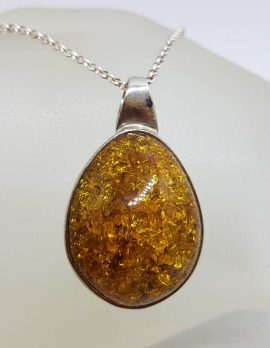 Sterling Silver Freeform Natural Baltic Amber Bezel Set Pendant on Silver Chain