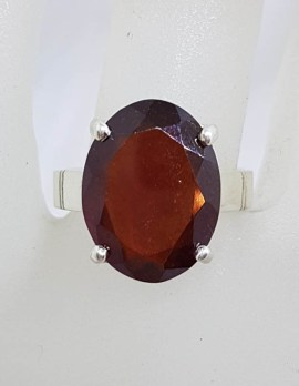 Sterling Silver Large Oval Claw Set Garnet Ring