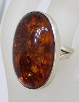 Sterling Silver Large Oval Bezel Set Amber Ring