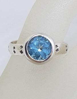 Sterling Silver Round Topaz in Bezel Setting with Patterned Band Ring