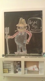 Drawn on our chalkboard at home. A country bumpkin farmer.