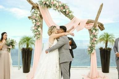 they kiss after the ceremony under the gazebo,beach palace,cancun,mexico