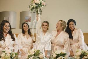 Kristen and bridal party getting ready for the wedding