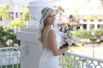 bride poses for pictures in playa del carmen