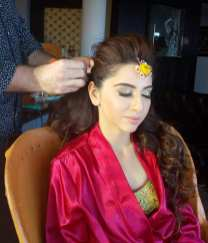 indian bride gets hair and make up done for sangeet,riviera maya, mexico