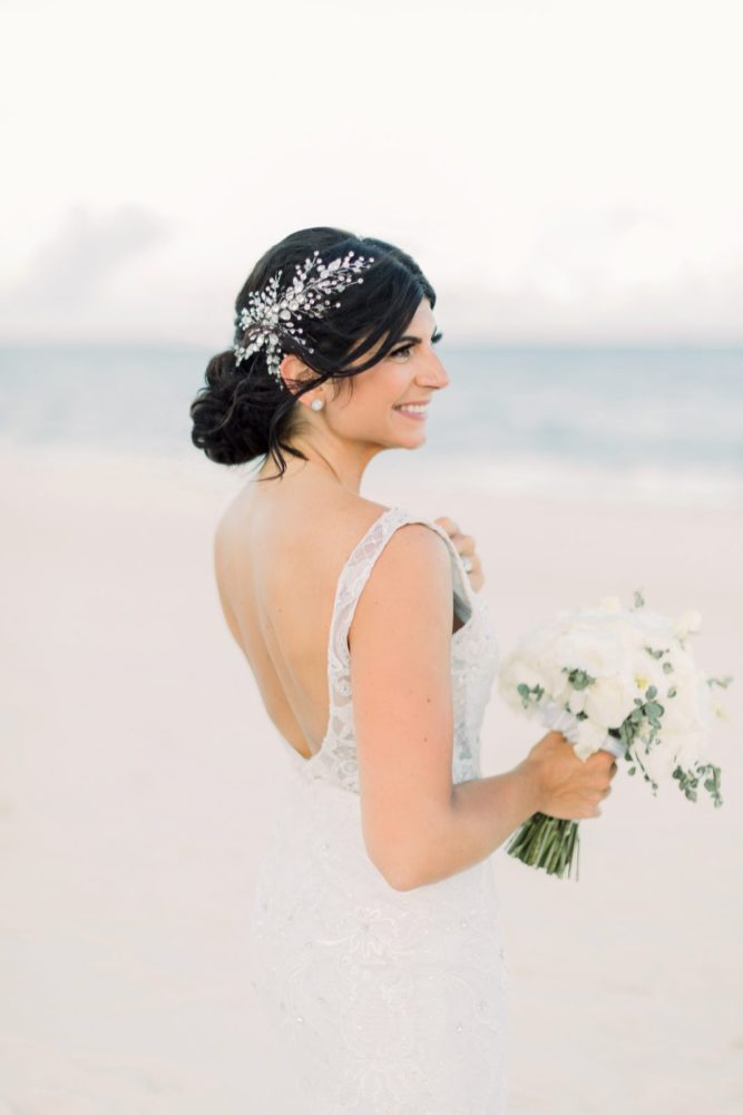 bride poses at the beach